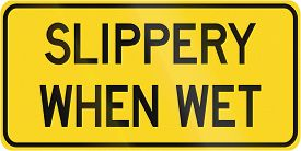 image of slippery-roads  - Warning road sign in Canada  - JPG