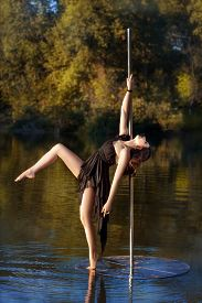 picture of lap dancing  - Beautiful girl posing near a pole dance - JPG
