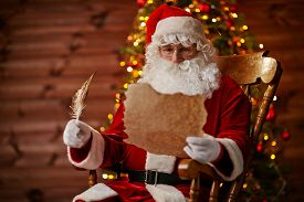 picture of letters to santa claus  - Santa Claus reading Christmas letter - JPG