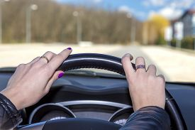 picture of steers  - Hands of female driver on steering wheel Woman holds the passenger car steering wheel - JPG