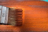 Brush With Paint In Hand. A Man Paints Blue Boards In A Brown Paint Brush. poster