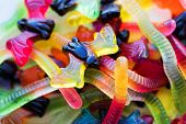 halloween, junk food and confectionery concept concept - heap of multicolored gummy worms and jelly  poster