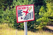 Inscription put It Out. Dont Leave. Old Rusty Metal Signs In The Chernobyl Zone. Radioactive Area poster