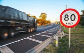 Big Truck Passing At High Speed On Road Exceeding Speed Limits poster