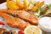 stock photo of salmon steak  - Salmon steak with roasted vegetables - JPG
