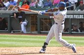 SCOTTSDALE, AZ - MARCH 7: Los Angeles Dodgers outfielder Trayvon Robinson takes a swing against the