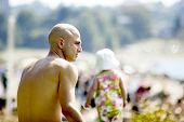 stock photo of skinhead  - man on beach - JPG