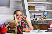 Kid And School Supplies On Classroom Background poster