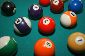 stock photo of pool ball  - pool balls in play on green felt table - JPG