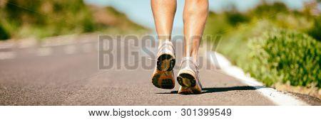 poster of Fit run runner man jogging feet closeup running shoes banner panorama. Athletes legs walking on stre