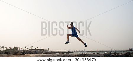 poster of Run Hard Or Walk Home. Running Man On Beach. Runner Training Outdoors. Fit Male Sport Fitness Exerci