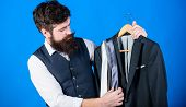 Shop Assistant Or Personal Stylist Service. Matching Necktie With Outfit. Man Bearded Hipster Hold N poster