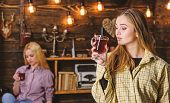 Friends On Relaxed Faces In Plaid Clothes Relaxing, Defocused. Friends Enjoy Mulled Wine In Warm Atm poster