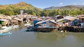 Aerial View Coron City With Slums And Poor District. Palawan.wooden Houses Near The Water.poor Neigh poster