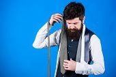 Building His Necktie Wardrobe. Bearded Man Choosing A Necktie Of His Wardrobe. Stylish Mens Wardrobe poster