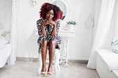 Fashionable Tall African American Model Woman With Red Afro Hair In Dress Posed At White Room, Sitti poster