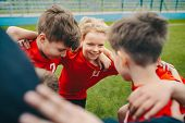 Happy Children Making Sport. Group Of Happy Boys Making Sports Huddle. Smiling Kids Standing Togethe poster