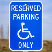 Clear Square Blue Reserved Parking Van Accessible Sign With A Man On A Wheelchair Icon poster