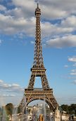 Eiffel Tower With Fountains Of Trocadero Quartier And Clouds On Blue Sky poster