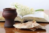 stock photo of covenant  - Chalice with red wine pita bread Holy Bible and white hyacinth