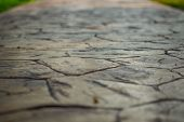 Close Up View Of Walkway Concrete Stamped Material, Selective Focus. poster