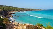 Cyprus Coastline. Sea Rocky Beach In Cyprus On Sunny Clear Day. Sea Shore Landscape With Turquoise W poster