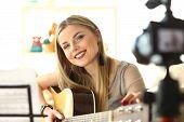 Happy Guitar Performer Recording Musical Vlog. Caucasian Cute Woman Sitting And Playing Music. Joyfu poster