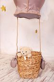 Teddy Bear Sitting In The Balloon Basket, Aerostat. Children  Location For A Photo Shoot: A Balloon  poster