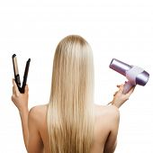 Blonde hair and hairdresser's tools