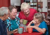 pic of hysterics  - Group of laughing seniors in a coffeehouse - JPG