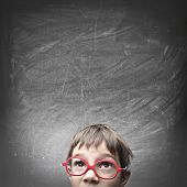 stock photo of nerd glasses  - Child with an empty blackboard over his head - JPG