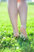 Female Beautiful Legs Stepping On Green Grass, Close-up View