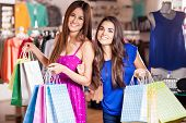 picture of boutique  - Happy women carrying shopping bags and doing some shopping together - JPG