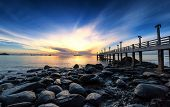 stock photo of long beach  - Sea pier sunset photography - JPG