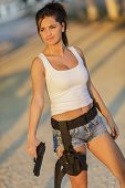 stock photo of girls guns  - Pretty young girl outdoors with the gun - JPG