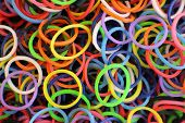 foto of loom  - Colorful rubber loom bands as a background pattern - JPG