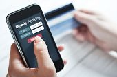 picture of electronic commerce  - Female hands using mobile banking on smart phone - JPG