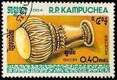 KAMPUCHEA-CIRCA 1984: A stamp printed in the Cambodia, shows a traditional musical instrument Skor,