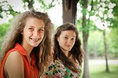 stock photo of sweet sixteen  - Portrait of two nice and smiling teenager girl - JPG