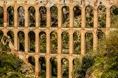 stock photo of aqueduct  - Old aqueduct in Nerja Costa del Sol Spain - JPG