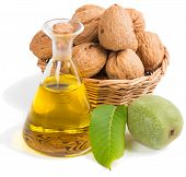 Постер, плакат: Walnut Oil In A Glass Bottle With Nuts