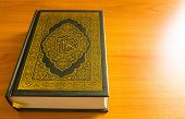 stock photo of quran  - The quran on the wooden table background - JPG