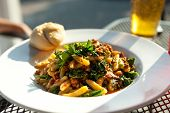 pic of sausage  - Broccoli rabe dish with sausage over penne pasta presented in a white dish - JPG
