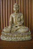 stock photo of budha  - the wooden budha on brown wood table - JPG
