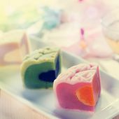 pic of mid autumn  - Colorful snow skin mooncakes on white plate with teacup - JPG