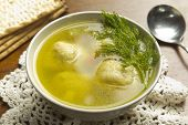 stock photo of matzah  - Delicious Matzoh ball soup with crackers wine and dill - JPG