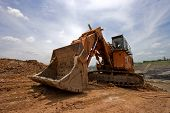 picture of risen  - track type loader excavator machine doing earthmoving - JPG
