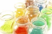 picture of pigment  - Close up image of colorful pigments in open glass jars