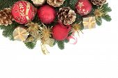 picture of greenery  - Christmas background border with bauble decorations and winter greenery over white with copy space - JPG