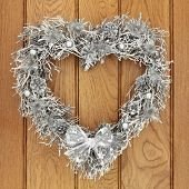 stock photo of scottish thistle  - Heart shaped christmas wreath with silver thistle - JPG